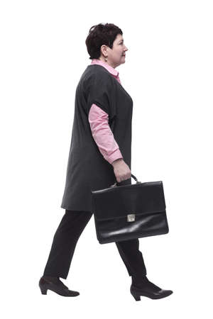 side view. business woman with leather briefcase striding forward