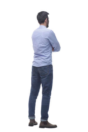 side view . casual young man reading an ad on a white screen.
