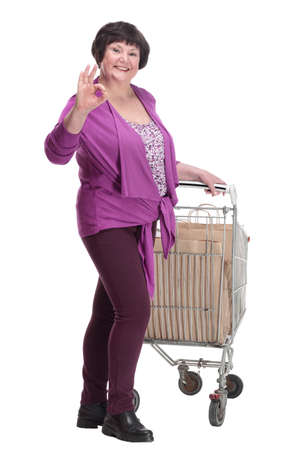 casual an elderly woman with a shopping cart.