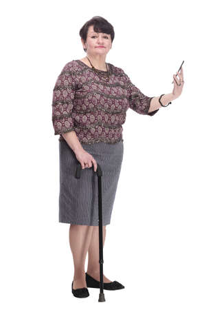 full-length. casual elderly woman with a mobile phone.