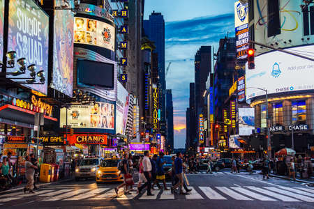 July 2016 people are crossing the street Times Square during sunset, Manhattan, New York United State