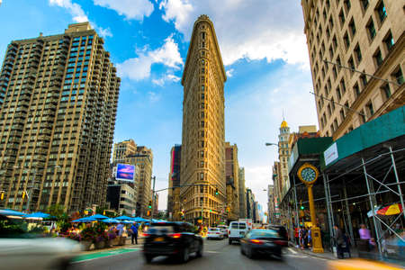 Summer 2015 Flatiron Building at Fifth Avenue and taxi cabs, New York USA Editorial