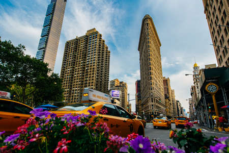 fifth avenue: Summer 2015 Flatiron Building at Fifth Avenue and taxi cabs, New York USA Editorial
