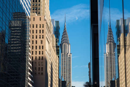 Chrysler Building at daylight with moon in winter afternoon