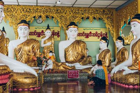 Yangon, Myanmar - FEB 19th 2014: Golden buddha statue at Shwedagon golden pagoda