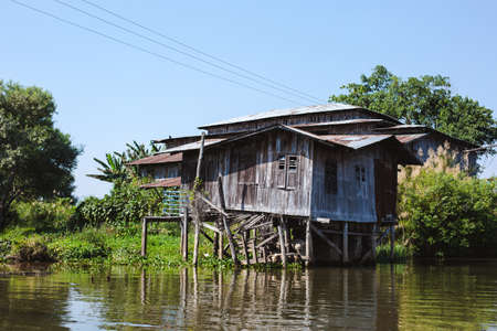 Inle Lake, Myanmar: FEB 25, 2014: Wooden stilt houses on piles inhabited by the tribe of Inthar
