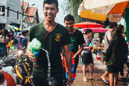 People and Tourists Join Songkran Water Festival In the middle of Chiang Mai | APR 13, 2013 | EDI CHEN Stock Photo - 117651263