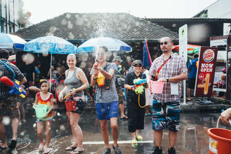 People and Tourists Join Songkran Water Festival In the middle of Chiang Mai | APR 13, 2013 | EDI CHEN Stock Photo - 117651266