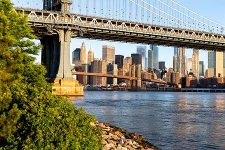 New York City  USA - JUN 25 2018: Brooklyn Bridge Park with Lower Manhattan skyline at sunrise Redakční