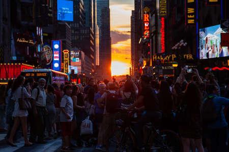 New York City  USA - JUL 13 2018: Manhttanhenge street view from Times Square at rush hour in midtown Manhattan
