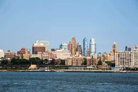 New York City  USA - JUL 14 2018: Brooklyn downtown skyline view from Governors Island ferry on a clear afternoon Editorial