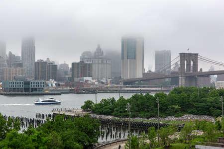 New York, NY  USA - JUN 01 2018: Lower Manhattan skyline on a foggy afternoon Editorial