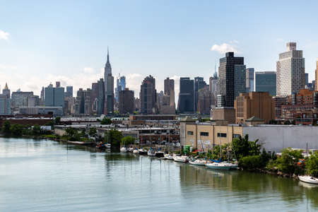 New York, NY  USA - JUN 01 2018: Manhattan midtown skyline view from Queens on a clear afternoon Editorial