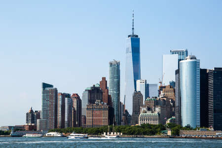 New York City  USA - JUL 14 2018: Lower Manhattan Skyline view from Governors Island ferry on a clear afternoon