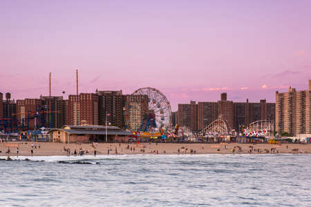 Brooklyn NY - USA - May 20 2019: Sunset on the beach of Luna Park in Coney Island New York City Editoriali