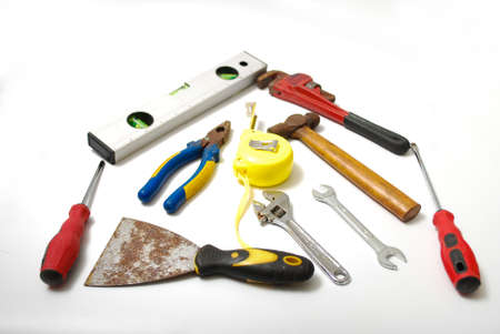 Assorted work and home tools. Isolated white background and copy space
