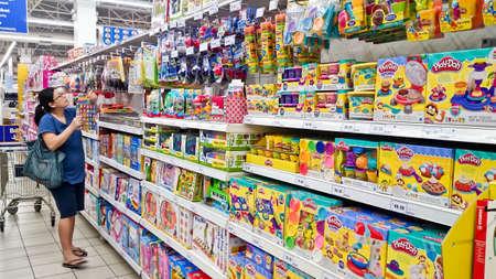 MELAKA, MALAYSIA - April 13, 2018 : Assorted toys on shelf rack display in the Tesco store.