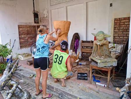 MELAKA, MALAYSIA - April 11, 2018 : An artist make a statue by a muddy Editorial