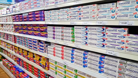 MELAKA, MALAYSIA - April 13, 2018 : Assorted brand of toothpaste on shelf rack display in the Tesco store. Editorial