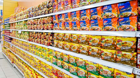 MELAKA, MALAYSIA - April 13, 2018 : Assorted brand and type instant noodles mee on shelf rack display in the Tesco store. Editorial