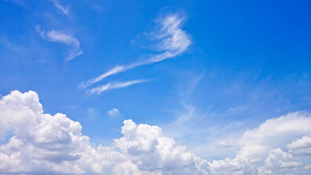 White cloud with blue sky. Clean and clear with sun light. Suitable for made a background 스톡 콘텐츠