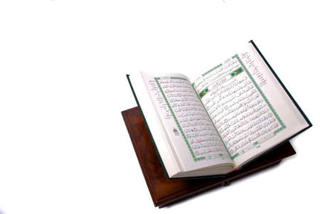 The holy Quran isolated over white background. Muslim holy book and guidance
