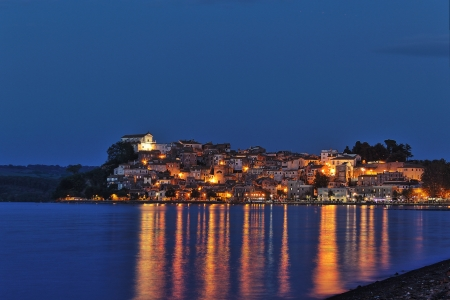 A night shot of Anguilara Sabazia, a very nice village on the shore of Bracciano lake near Rome, Italy photo