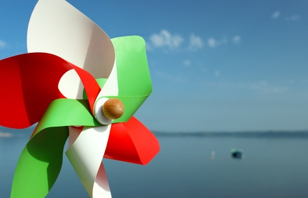 A shot of a pinwheel coloured with italian national flag colours photo
