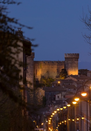 Street lamps in the evening with Bracciano Orsini Castle in Background photo