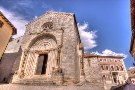 san quirico dorcia: The facade of a medieval baptistery in San Quirico dOrcia, near Siena, Tuscany, Italy