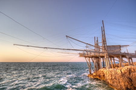 A night view of a typical trabucco, an apulian wooden construction for fishing by a system of nets