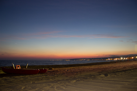 baywatch: A night view of a baywatch boat on a beach    Stock Photo