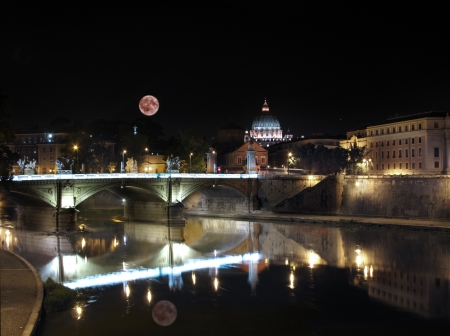 A night view of St Peters basilica, and St Peter skyline, from Tevere river very famous landmark in Rome, italy