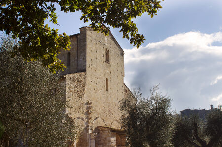 antimo: A view of the medieval facade of Sant'Antimo Abbey, near Siena, Tuscany, Italy Stock Photo