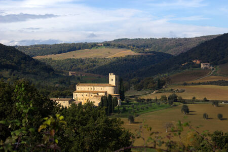 antimo: A view of the medieval abbey of Sant'Antimo, near Siena, Tuscany, Italy and the surroundings Stock Photo