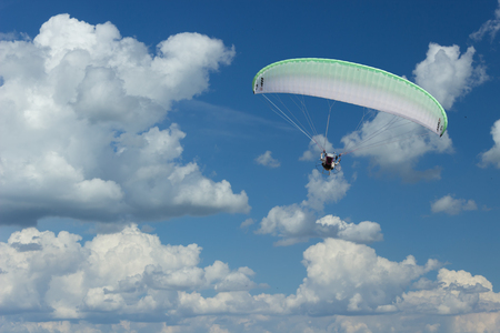 A motor parachute or paramotor flying in the sky