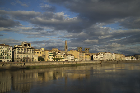 Lungarno delle Grazie, viewed from famous Ponte Vecchio in Florence, Italy in a cloudy afternoon