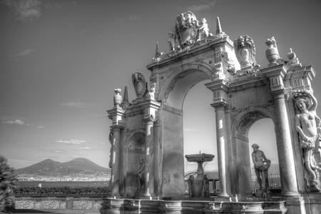 Iconic b&w image of Fontana del Gigante at Via Partenope, in Naples, Italy, with Vesuvius mount on the background
