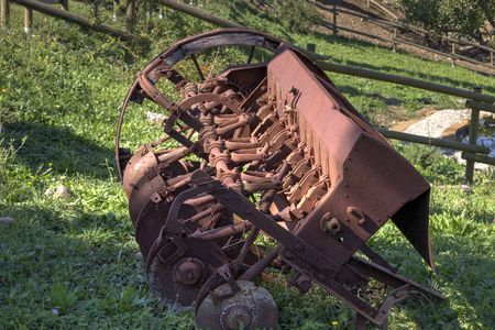blighted: An old and blighted plow standing in a green field