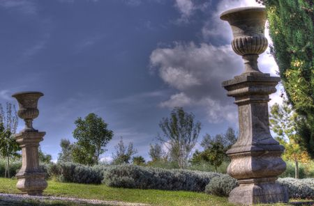 A scenic estate gate of marble columns and vases in Tuscany, Italy