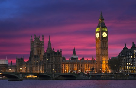 The very famous icon london palace of Parliament and Big Ben bell tower at dusk During a stunning sunset and illuminated