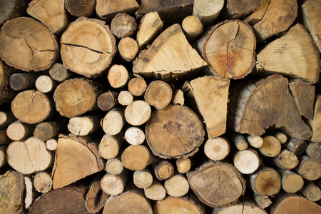 Ordered pile of dry wood cut for burning in fireplace Standard-Bild