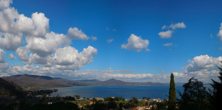 A panoramic view of Bracciano lake, near Rome, Italy in a clear, sunny spring day