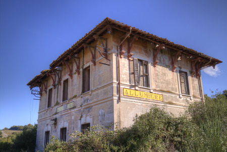 The old, abandoned station of Allumiere, near Rome, Italy, on an old disused railroad Standard-Bild