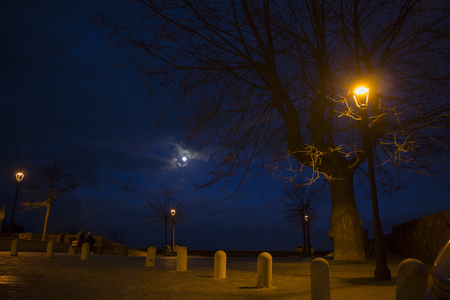 A typical corner in Bracciano, a nice medieval village next to Rome, Italy, at night with the moon