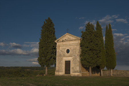 The iconic church of Madonna della Vitaleta, in Val D'Orcia, near Pienza, Tuscany, in a clear, sunny day