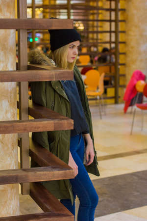 holiday spending: portrait of stylish young girl in the Mall