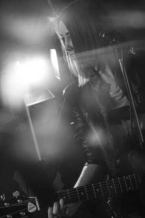 girl playing guitar: the girl playing guitar in the Studio