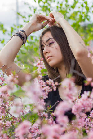 portrait of young beautiful girl in flowers photo