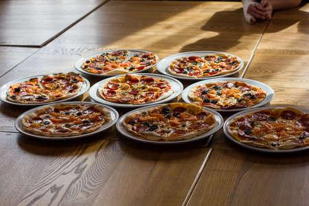 freshly prepared: freshly prepared delicious pizza in the kitchen Stock Photo